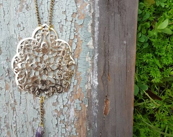 Gold filigree necklace with raw amethyst stone