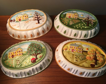 Vintage set of four hanging ceramic molds celebrating the seasons made in Japan