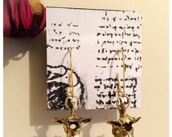 Gold Raven vertebrae dangle earrings