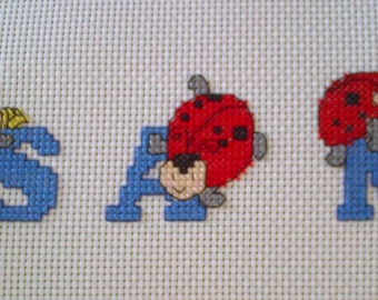 Lovely completed Boys / Girls Ladybird Cross Stitch Name Sampler