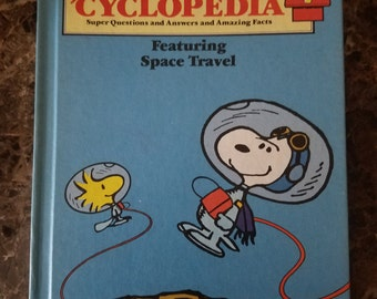 Vintage Charlie Brown's Encyclopedia Educational Book, Volume 7, Childrens Book, Snoopy Peanuts Learning Space Travel, Blue Charles Schulz