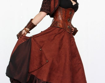 Long brown Victorian Steampunk skirt with asymmetric spread and gold buttons on right side and frill on the bottom