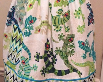 "You see ""Mucho Geckos"" on this little fun, bright colored apron. Monogram extra  SML"