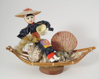Japanese Vintage doll, Ama in bamboo boat, kitsch doll