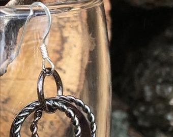 Black sparkling triple hoop earrings