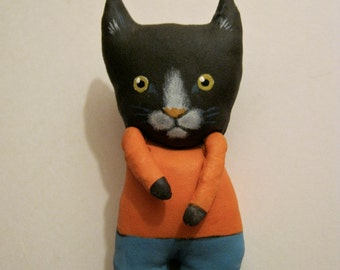 boy cat art doll , little black cat , sandy mastroni, whimsical , orange shirt, wall art doll , shelf art,