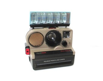 Vintage Polaroid Pronto Sonar Camera with Unused Flashbars, Sears Special Polaroid