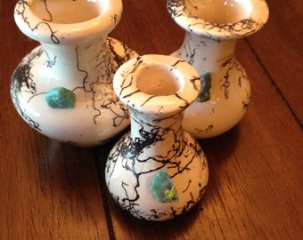 small ornamental vases with turquoise stones