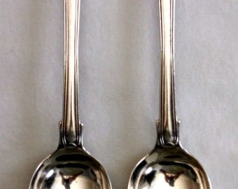 Pair of George IV sterling silver Fiddle, Thread and Shell serving spoons, monogram