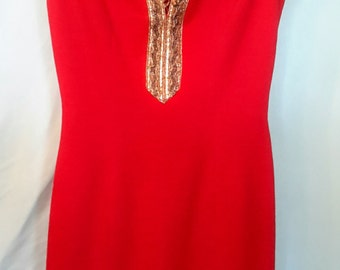 1970' s  sleeveless red form fitting g dress with told and black embellishments, size 7-8