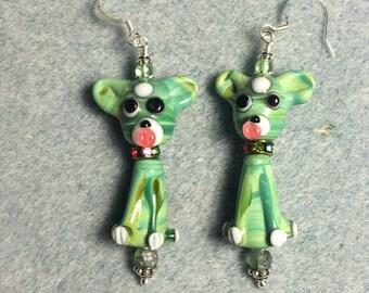 Green puppy dog lampwork bead dangle earrings adorned with green Czech glass beads.