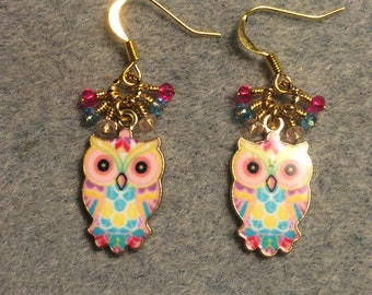 Pink and turquoise enamel owl charm earrings adorned with tiny dangling pink and turquoise Chinese crystal beads.
