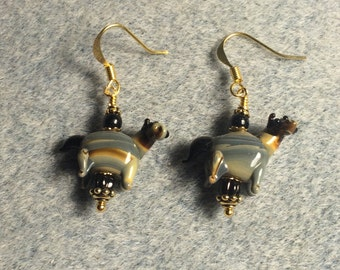 Black, tan and grey lampwork horse bead earrings adorned with black Czech glass beads.
