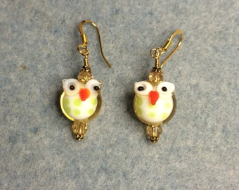 Amber with green polka dots round lampwork owl bead earrings adorned with amber Chinese crystal beads.