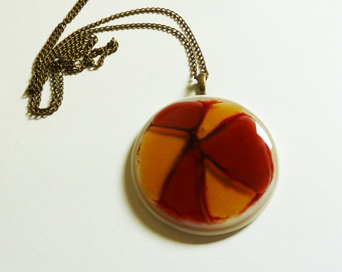 Large fused glass pendant, red, amber and cream glass