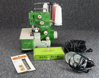 Juki EA-605 Baby Lock Sewing Machine With Pedal, Carrying Case, And Accessories