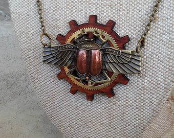 Steampunk scarab necklace with aAustralian sheoak and brass cog Alchemy Alice Designs