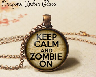 "Keep Calm and Zombie On Necklace - 1-1/4"" Circle Pendant or Key Ring - Wearable Photo Art Jewelry - Halloween Costume, Horror, Goth Gift"