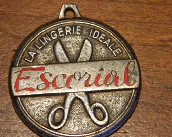 """Vintage French Advertising Souvenir Medallion """"Escorial La Lingerie Ideale"""""""