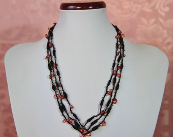 Black crochet necklace with red stones
