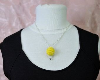 Necklace with scented wood ball coated with crochet technique