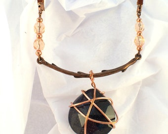 Pendant necklace with blue goldstone, copper, and leather