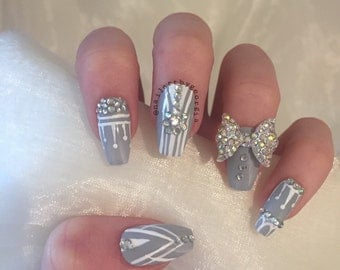 Grey and white coffin false nails with rhinestones and 3d rhinestone bow
