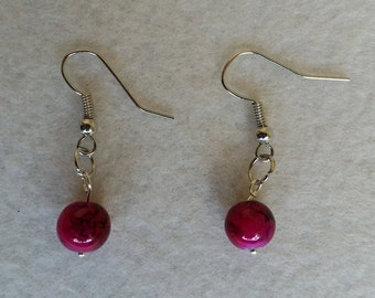 Sterling silver earrings with deep pink glass drawbench beads.