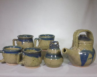 Apple Green and Blue Ceramic Teapot with Four Mugs and a Sugar Bowl.