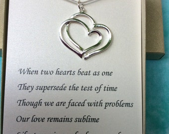 Sterling Silver Love necklace and pendant w/ poem. Two hearts beat as one necklace