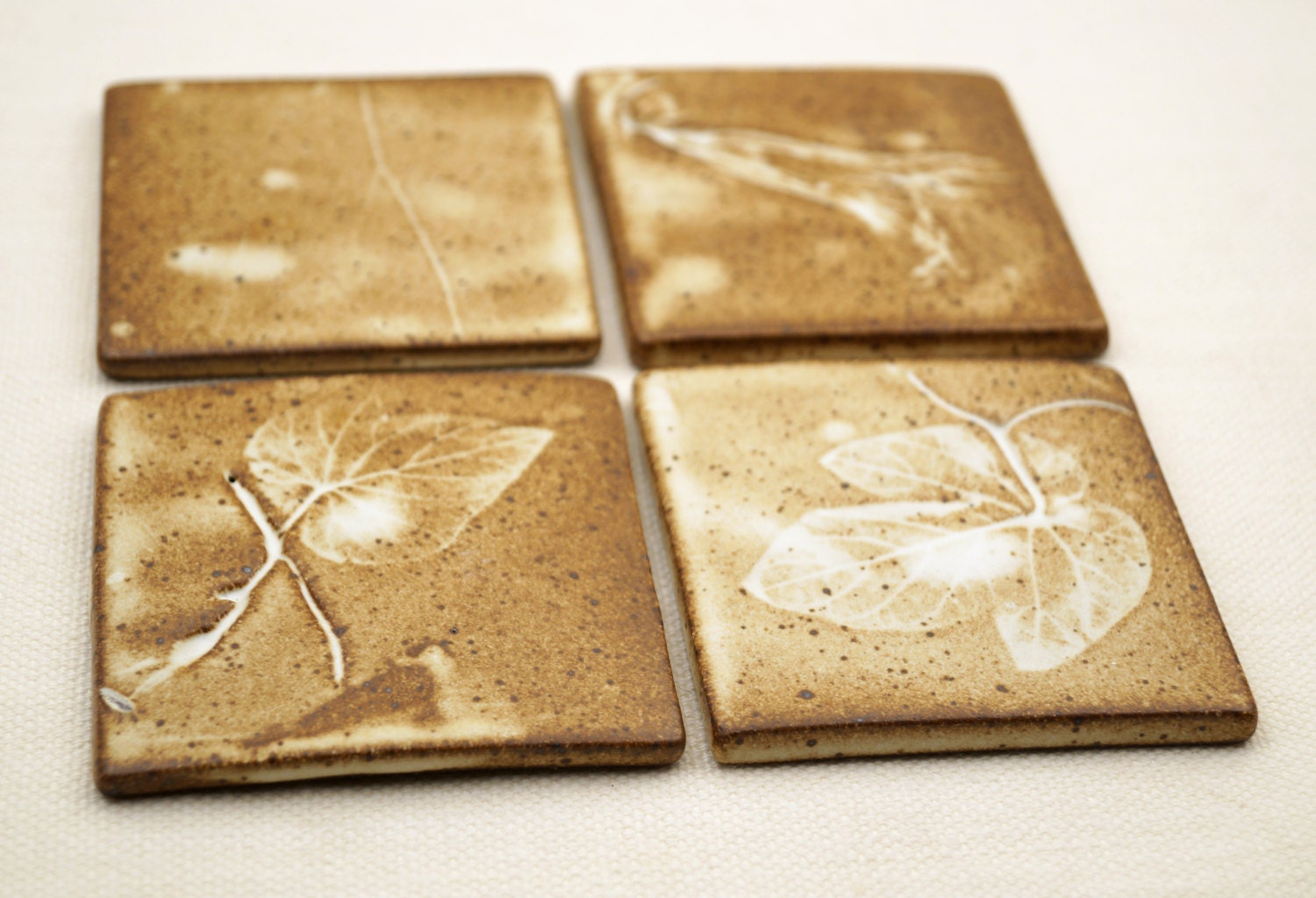 Ceramic hand made tilescoasters set of 4 one of a kind ceramic ceramic hand made tilescoasters set of 4 one of a kind ceramic tiles real greap leavesvine imprint rustic matte glaze unique gift idea dailygadgetfo Choice Image