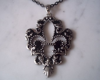 """BLACK AND SILVER pendent....on a black chain....18"""" chain"""