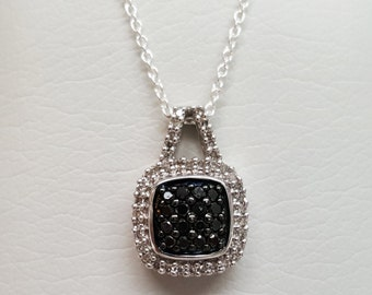 Sterling Silver 40=0.40CTW White and 16=0.32CTW Black Diamond Pendant
