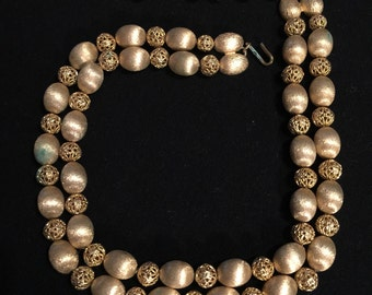 1960 brass beaded double strand necklace with patina