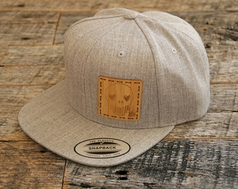 Artist Series 001-Limited Edition Collaboration With Ten Hundred: Original Art Laser Engraved Onto Bamboo +Stitched On Heather Grey Snapback