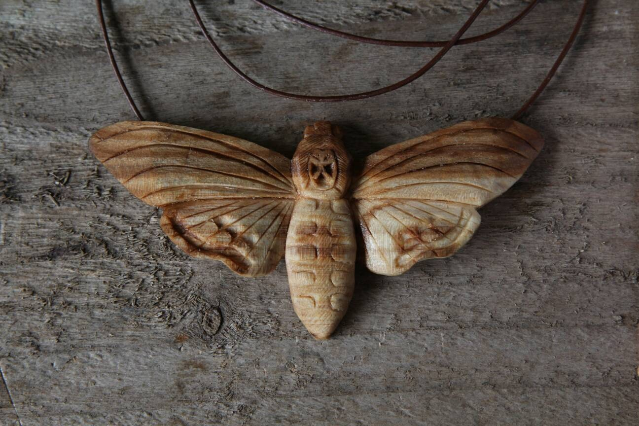 Hand carved death s head moth elm wood pendant necklace