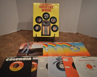 Collection of 1980's Country Music 45s and The Best of Country Music Booklet