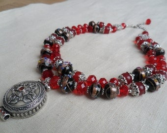 Red and black Necklace with sterling silver pendant.