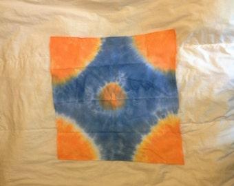 Blue , orange & white bandana.