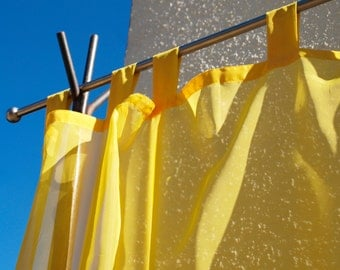 A few uni-Voile Curtains/curtains/curtains in yellow, semi-transparent, with loops