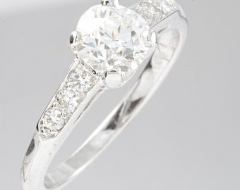 Vintage .90 carat Old European Diamond Platinum Engagement ring. Circa 1930.