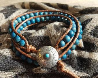 Men's bracelet with silver button clasp