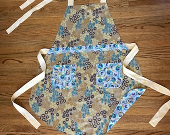 Reversible Women's Apron in a Tan Floral Silk Screen Print. Perfect for Fall Entertaining!