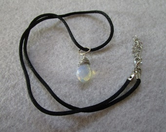 the small and enchanting deardrop pendant/ necklace with delicate understated wire wrap on faceted bead.