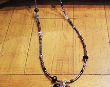 Dichroic glass pendant on seed beads with assorted semi precious stones and crystals
