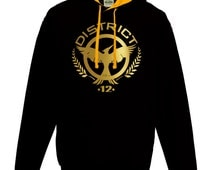 Hunger Games inspired Mockingjay district 12 black and gold contrast unisex hoodie.