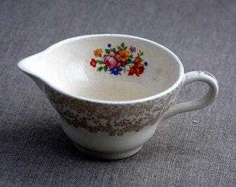 Vintage Off-White Creamer with Gold Design on the Outside and Flower Design on the Inside