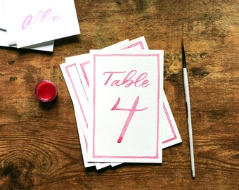 Watercolor table numbers in modern calligraphy for weddings, parties and events