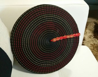 Black, red and gold basket hat for Shalese