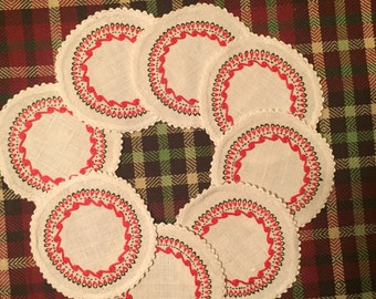 Set of eight vintage cloth and embroidery coasters